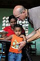 US Navy 080809-N-8907D-023 Lt. Cmdr. Louis Cimorelli, assigned to Fleet Surgical Team 4 embarked aboard the amphibious assault ship USS Kearsarge (LHD 3), performs a check-up on a Nicaraguan child.jpg