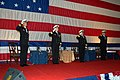 US Navy 090225-N-7656T-164 Senior officers render salutes as the colors are retired at the conclusion of the change of command ceremony aboard George H.W. Bush.jpg