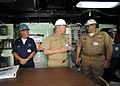 US Navy 090331-N-8273J-272 Chief of Naval Operations (CNO) Adm. Gary Roughead, center, speaks with Quartermaster 2nd Class Jonathan Voldberg, left, and Commanding Officer Capt. Robert George Kopas during a visit to the amphibio.jpg