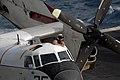 US Navy 090704-N-9132C-046 Lt. Steven Parente cleans the window of a C-2A Greyhound aircraft aboard the aircraft carrier USS Ronald Reagan (CVN 76).jpg