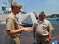 US Navy 100411-N-7058E-070 Cmdr. Randy Garner explains the targeting system for USS Freedom (LCS 1) to Mexican navy Adm. Nestor Yee.jpg
