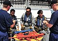US Navy 100506-N-7643B-049 Guardsmen assigned to the U.S. Coast Guard cutter Mellon (WHEC 717) ready a Royal Brunei Navy boarding team with mock weapons during a visit, board, search, and seizure exercise.jpg
