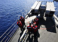 US Navy 100829-N-0569K-079 Sailors assigned to the combat systems department of the aircraft carrier USS Enterprise (CVN 65) assemble a ship-launched, intercept-aerial guided missile (RIM-7).jpg