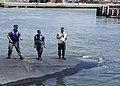 US Navy 110615-N-XX999-021 Sailors aboard the Los Angeles-class attack submarine USS Helena (SSN 725) secure the boat to the pier at Naval Station.jpg