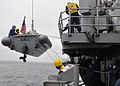 US Navy 110626-N-PB383-707 Sailors aboard USS McClusky (FFG 41) lower a rigid-hull inflatable boat during a four-day underway period.jpg