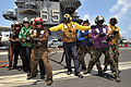US Navy 110712-N-CH661-024 Sailors conduct a firefighting training exercise aboard USS Enterprise (CVN 65).jpg