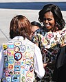 US Navy 111027-N-GO855-076 First lady Michelle Obama greets a Girl Scout at Naval Air Station Jacksonville.jpg