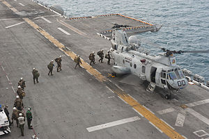 US Navy 111214-N-DX615-171 Marines embark a CH-46E Sea Stallion helicopter.jpg
