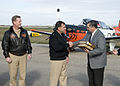 US Navy 120206-N-LY958-166 Navy representatives presents Dr. Mark Escamilla, president of Del Mar College, with maintenance logs for two T-34 Turbo.jpg