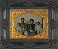 Unidentified African American soldier in Union uniform with wife and two daughters.png
