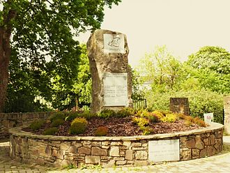 Kanturk - Kanturk Unity Park  The Unity Stone The heart beat is the river Sky is imagination's face We bridge all forever Stars in universal space  Inscription on the lower plaque:  This Park was open by President Mary McAleese  on 7 July 1998