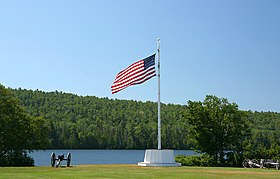 Flagpole in front of Lake Fanny Hooe at Fort Wilkins