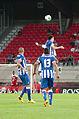Valais Cup 2013 - OM-FC Porto 13-07-2013 - Herrera à la lutte avec André Ayew sous les yeux de Danilo et Maicon.jpg