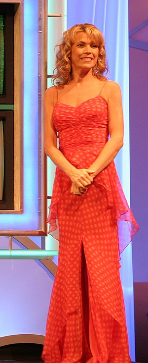 Vanna White - White next to the Wheel of Fortune board during a taping of Wheel of Fortune on February 8, 2006