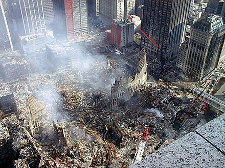 Overview of the site following the attacks. The Deutsche Bank Building is visible behind an angled red crane. WTCgroundzero.jpg