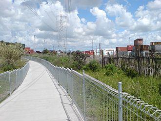 Waikaraka Cycleway - The cycleway along a container freight depot.