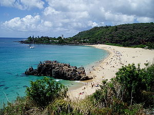 "Waimea Bay, Hawaii - ""The Rock"" and bay from Kamehameha Highway"
