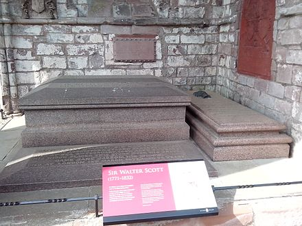 Sir Walter Scott's grave at Dryburgh Abbey - the largest tomb is that of Sir Walter and Lady Scott. The engraved slab covers the grave of their son, Lt Col Sir Walter Scott. On the right is their son-in-law and biographer, John Gibson Lockhart Walter Scott grave Dryburgh Abbey 20140527.jpg