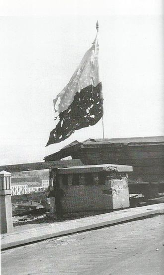 Flag of Poland - A frayed Polish flag during the final days of the Warsaw Uprising of 1944
