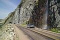 Waterfall coming onto the road (5161866406).jpg