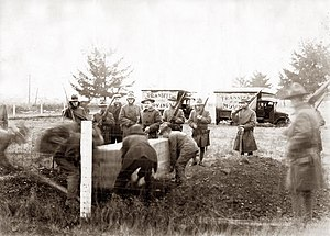 Centralia massacre (Washington) - The burial of  Wesley Everest, with an armed National Guard unit.