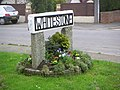 Whitestone Village sign with spring flowers - geograph.org.uk - 341776.jpg