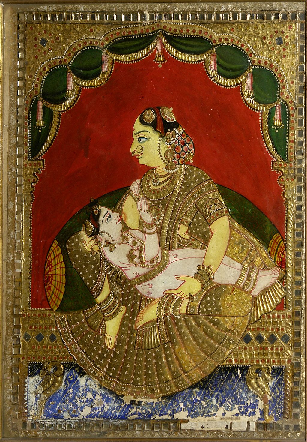 Woman breast-feeding a boy, Crafts Museum, New Delhi, India