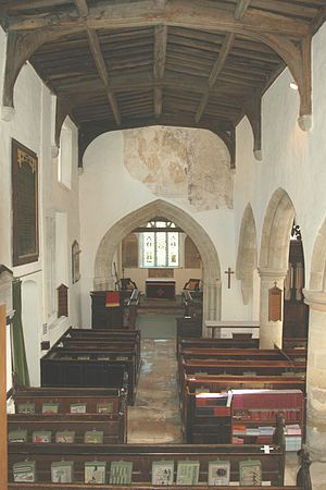 Yarnton - St. Bartholomew's nave, showing Early English chancel arch and remains of 15th century wall painting