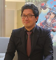 A photograph of the game's producer, Yuki Naka, in 2015