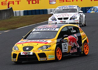 2008 World Touring Car Championship - Yvan Muller (front) and SEAT won the 2008 championships, succeeding Andy Priaulx (behind) and BMW.