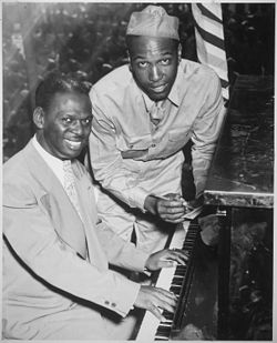 """Earl `Father' (Fatha) Hines, a great swing musician, is shown with Pvt. Charles Carpenter, former manager of the Hines - NARA - 535834.jpg"