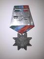 Медаль «За заслуги перед Республикой Карелия» (оборотная сторона).png