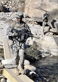 110123-F-2558S-080 - PO1 Brylan Riggins left with the Nuristan Provincial Reconstruction Team crosses a temporary bridge on the Alingar.jpg