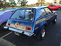 1973 AMC Gremlin X package in blue with gold at AMO 2015 meet 2of8.jpg