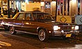 1975 Plymouth Valiant Brougham in brown, by night.jpg