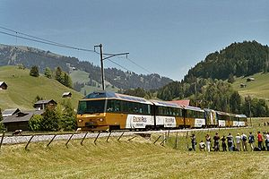 Montreux Oberland Bernois Railway - Golden Pass Panoramic passing near Rougemont during centennial celebration on 29 May 2004