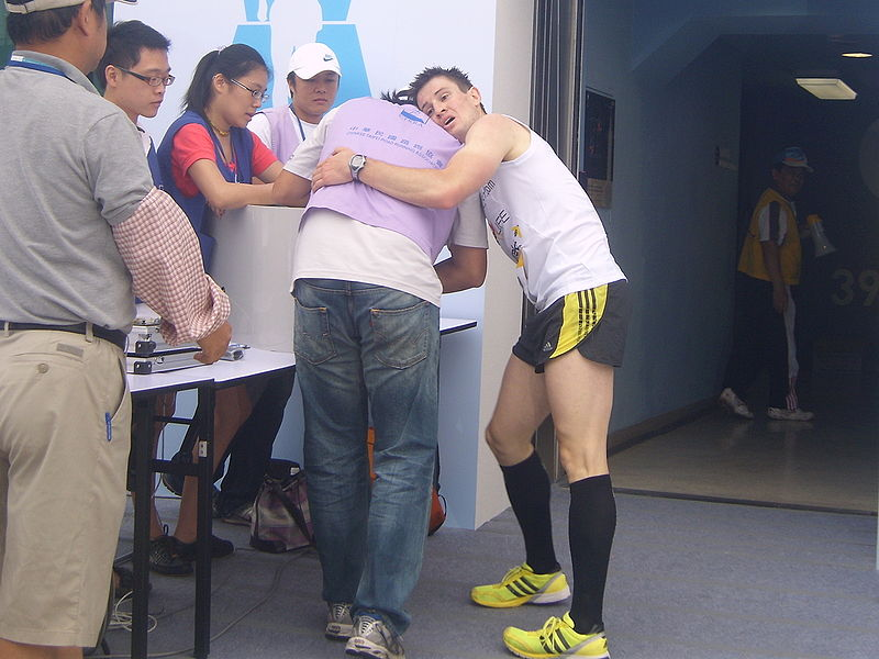 File:2009 Taipei 101 Run Up Thomas Dold tired down after finishing his race.jpg