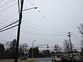2014-12-24 14 58 04 Traffic signal, utility poles and sodium vapor street light at the intersection of Pennington Road (New Jersey Route 31) and Charles Ewing Boulevard in Ewing, New Jersey.JPG