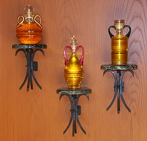 Ambry - Ambry containing vessels for holy oil: Chrism, Oil of catechumens, and the Oil of the Sick.