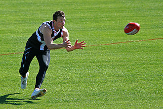 "Mark (Australian rules football) - Robert Eddy of St Kilda positions himself for the difficult ""out in front"" mark"