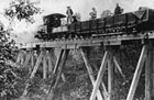 5t Decauville 0-4-0T locomotive on wooden trestle bridge during construction of the 600mm gauge Phủ Lạng Thương-Lạng Sơn line.jpg
