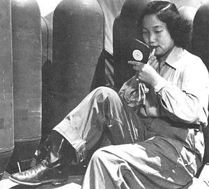 """Air Resupply And Communications Service - A female South Korean intelligence agent, known as a """"Rabbit"""" preparing to parachute from a C-47 deep inside enemy territory, 1951."""