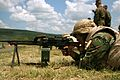 A Bulgarian machine gunner with the Bulgarian Army's 38th Infantry Battalion, 2nd Light Infantry Brigade, engages targets with a PK machine gun at the Novo Selo Training Range in Bulgaria June 16 110616-M-OB762-003.jpg