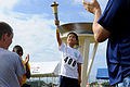 A Special Olympics (SO) athlete holds the torch during a Kadena Air Base SO event in Okinawa, Japan, Nov 111105-F-FL863-004.jpg
