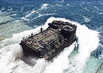 A U.S. Marine Corps amphibious assault vehicle plunges into the Gulf of Thailand as it exits the well deck of the amphibious dock landing ship USS Tortuga (LSD 46) in preparation for a joint amphibious assault 130609-N-IY633-073.jpg