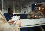 A U.S. Marine assigned to the 11th Marine Expeditionary Unit (MEU) looks through his hand of cards during a Morale, Welfare and Recreation-sponsored spades tournament aboard the amphibious assault ship USS Makin 120602-N-PB383-453.jpg