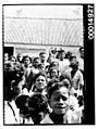 A crowd of young children outside a building, Nuku'alofa, Tonga (6943295552).jpg
