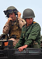 A member of the Royal Moroccan Armed Forces, foreground, sits in an amphibious assault vehicle before a ride with U.S. Marines assigned to Battalion Landing Team 1st Battalion, 2nd Marine Regiment, 24th Marine 120410-M-KU932-170.jpg