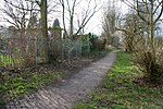 A walk round Martin's Pond (13). Looking back along the path by the side of the previous image with the Pond to the right and the back gardens of houses on Russell Drive on the left. See http://www.nottinghamcity.gov.uk/www/greenspaces/Docs/MartinsPondmap.pdf for a map of the site. Previous image: 728499, next image: 728505