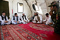 Abdul Patayal, the deputy provincial governor of Kandahar province, speaks with village elders during a shura, or meeting, held after a clinic opening ceremony in Mya Neshin district, Kandahar province 130601-A-IS772-210.jpg
